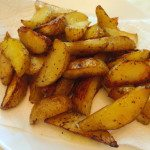 Homemade oven baked potato wedges on rubyparkbaking.com